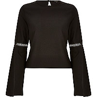 Black jersey bell sleeve top