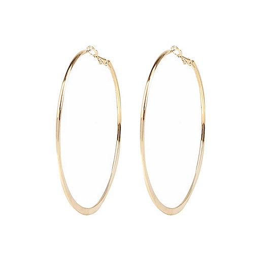 Gold tone medium flat bottom hoop earrings