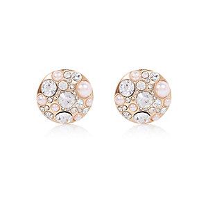 Gold tone circle pearl stud earrings