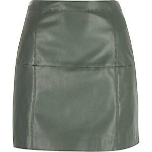 Light green leather-look mini skirt