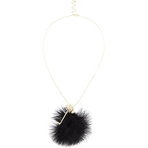 Gold tone pom pom key pendant necklace