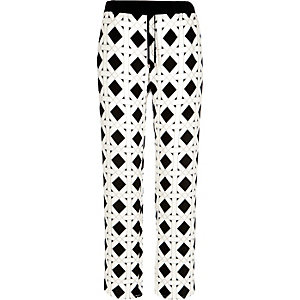 White diamond print wide leg trousers