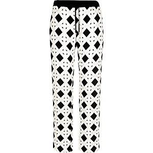 White diamond print wide leg trousers