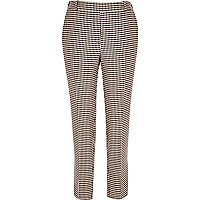 Red houndstooth print slim trousers
