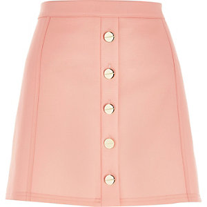 Light pink button-up A-line mini skirt