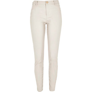 Cream leather-look skinny trousers