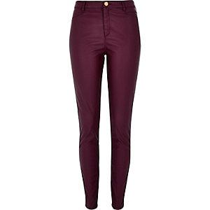 Dark red leather-look skinny trousers
