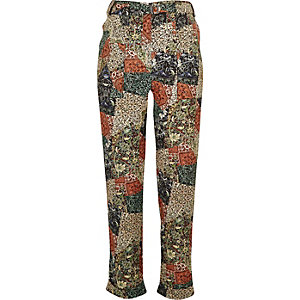 Green paisley print trousers