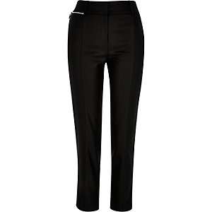 Black coated zip pocket slim trousers