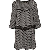 Black print swing dress