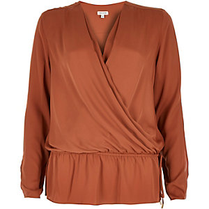 Rust brown wrap front peplum blouse