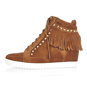 Tan suede fringed high top wedge sneakers