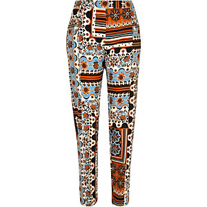 Orange print skinny tapered trousers