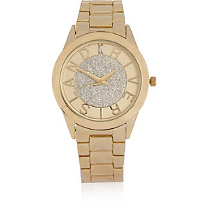 Gold tone branded glitter face watch