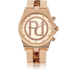 Gold tone chunky tortoise shell strap watch
