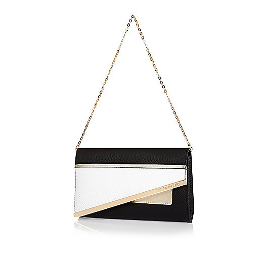 Black asymmetric clutch handbag