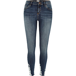 Dark wash ripped hem Amelie superskinny jeans