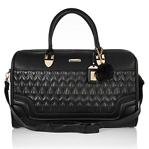 Black quilted pom pom weekend bag