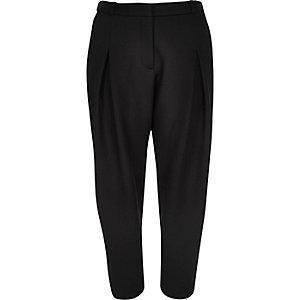 Black textured peg leg trousers