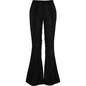 Black leather-look snake print flare trousers