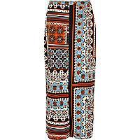 Orange print split front maxi skirt
