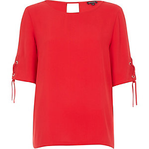 Red eyelet lace-up sleeve top