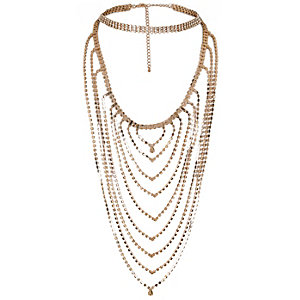 Gold tone layered embellished necklace
