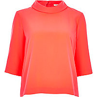 Bright pink high neck top
