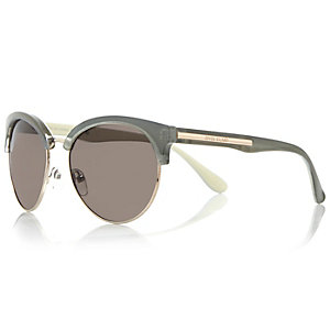 Light green clubmaster-style sunglasses