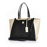 Black oversized winged tote handbag