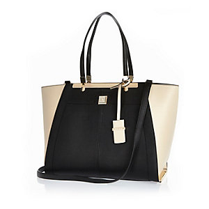 Black oversized winged tote handbag