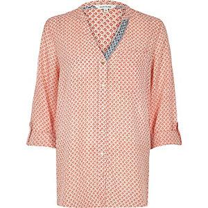Orange print V-neck shirt