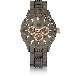 Black pyramid textured watch