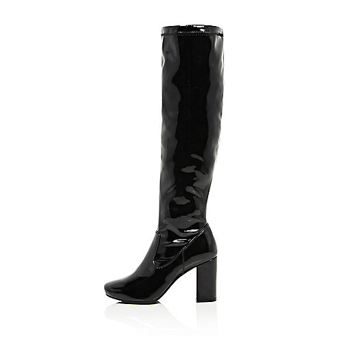 Black patent knee high heeled boots