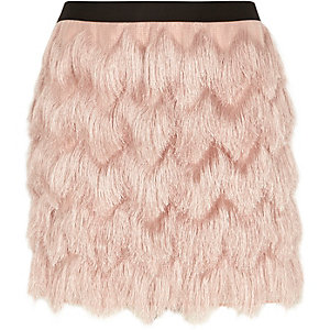 Light pink fringed mini skirt