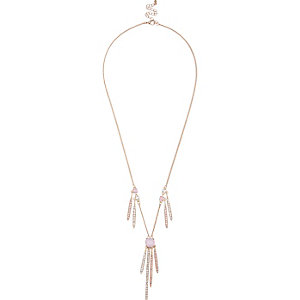 Gold tone pink elongated necklace