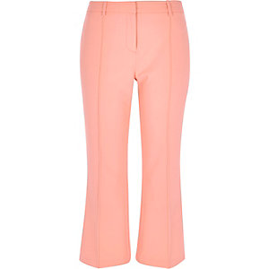 Light pink cropped kick flare trousers