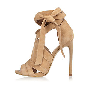 Beige suede tie up shoe boots