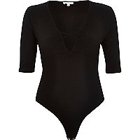 Black ribbed plunging neck bodysuit