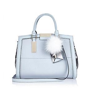 Light blue pom pom handbag