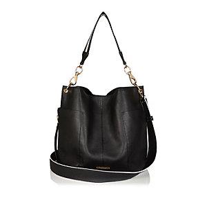 Black half white slouchy handbag
