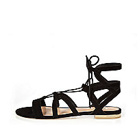 Black strappy lace up flat sandals