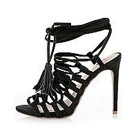 Black strappy tassel sandals