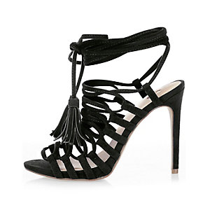 Black strappy tassel sandals