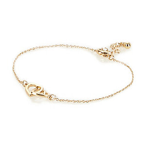Gold tone interlinking heart anklet