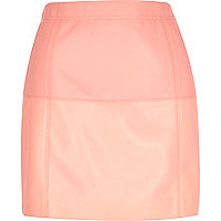 Pink leather-look pelmet skirt