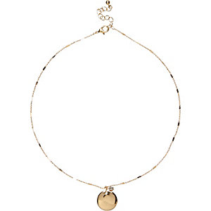 Gold tone delicate coin necklace