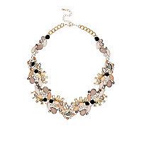 Gold tone pink gem necklace