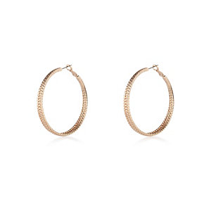 Gold tone embossed hoop earrings