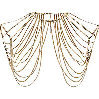Gold tone chain draped shoulder harness